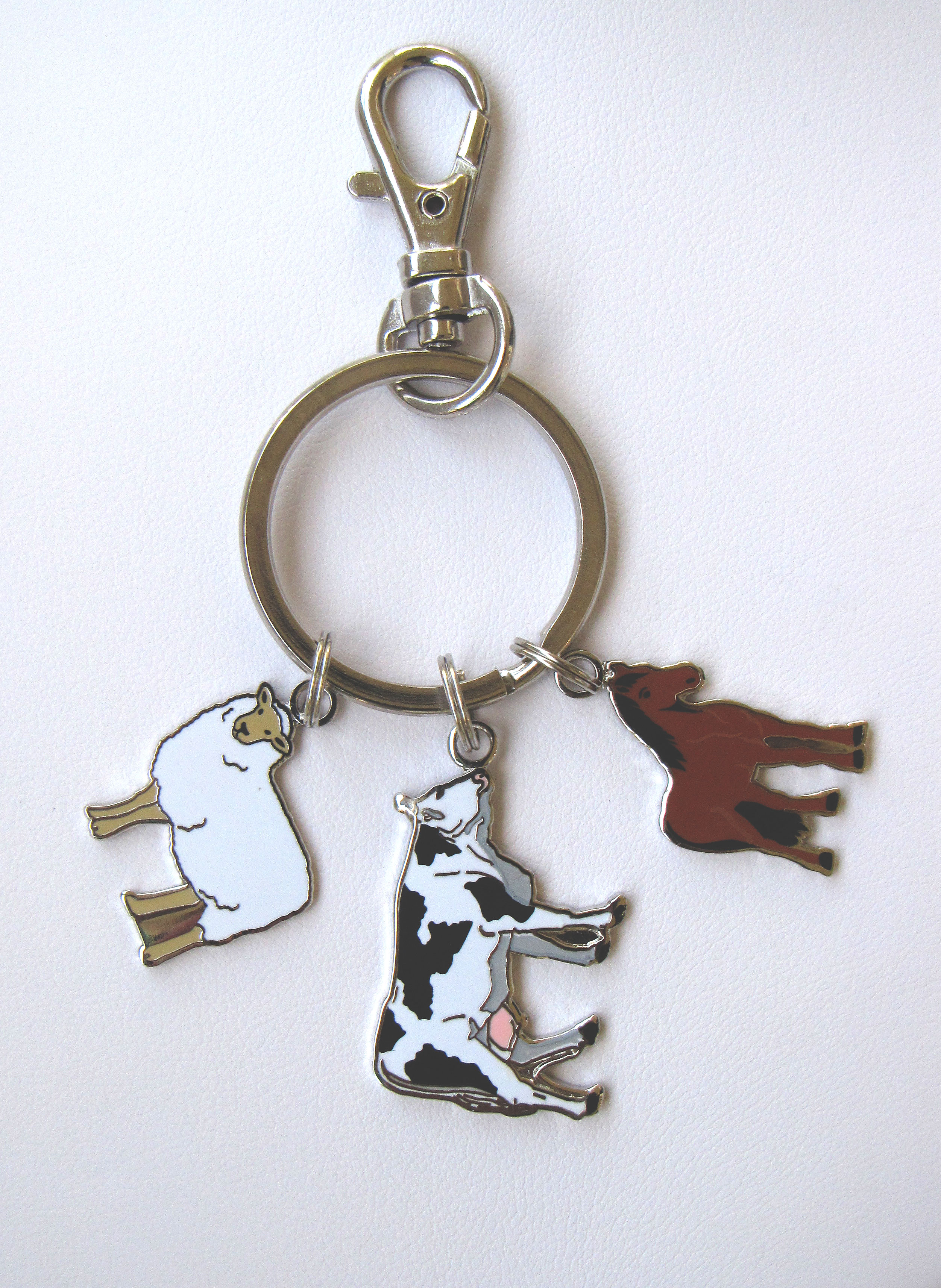 Three piece metal keychain, with sheep, cow, and horse.